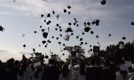 College graduates tossing caps