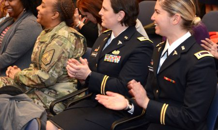 Women military veterans clapping