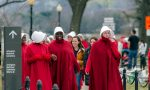Women dressed as handmaids